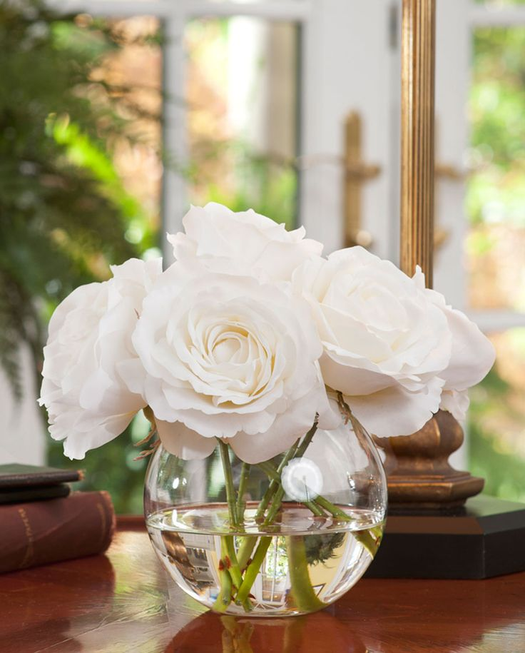 "This rose nosegay not only looks like the real thing but feels like it too. As in the Victorian era, the buttery soft petals of these lifelike silk roses are tightly nestled in a 5"" bubble ball vase and will prompt a second look. But unlike their live counterpart, our silk roses are arranged in crystal clear acrylic water which captures their beauty for a lifetime."