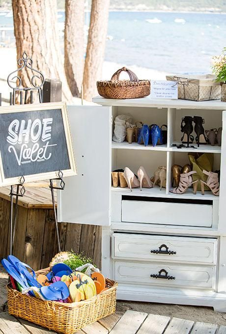 Provide a spot for guests to drop their shoes at your oceanfront ceremony | Brides.com
