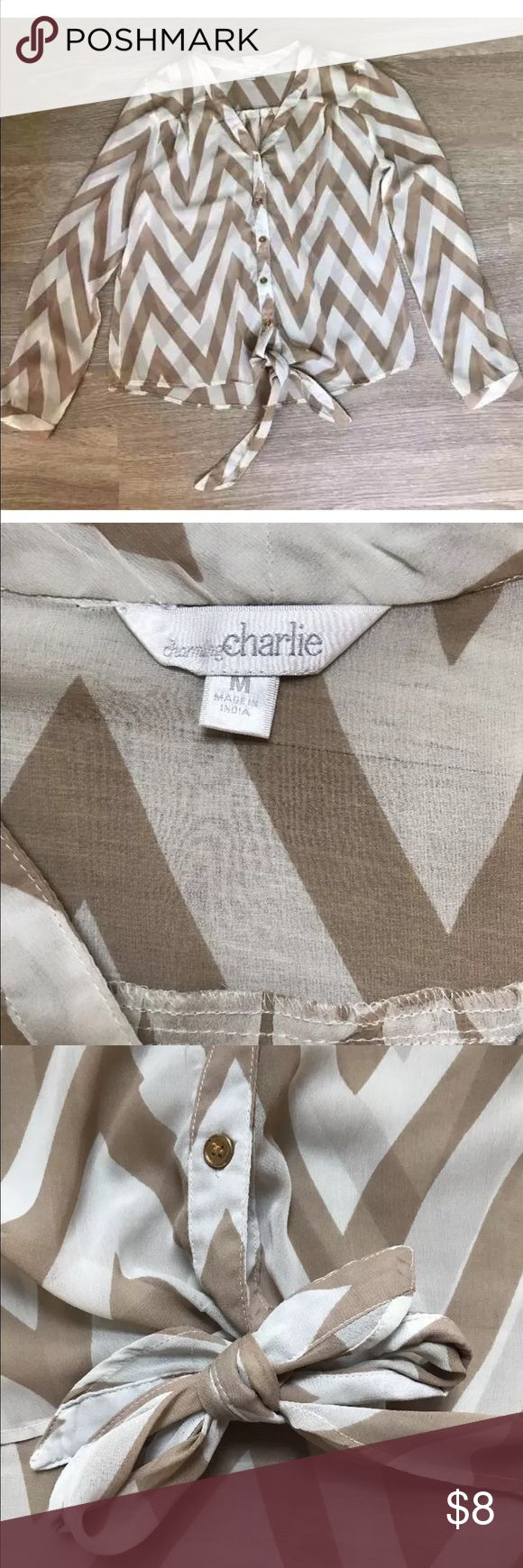 Charming Charlie Long Sleeve Women's Chevron Top Brand: Charming Charlie Size: Medium Style: Long Sleeve Button Down with Tie Front Patten / Color: Chevron white and beige Condition: Great Condition Blemish: Small black mark on Sleeve cuff (see photos) Charming Charlie Tops Blouses