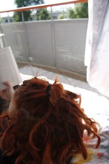 Martje. Short red dreadlocks