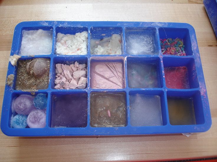 What will freeze? Experimenting with cloud dough, water beads, sandy water, coloured rice, and other objects.