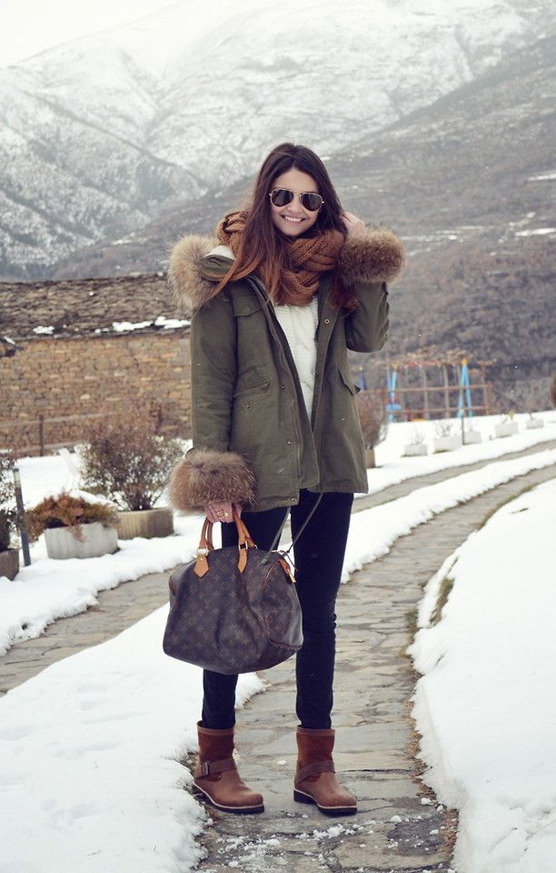 Shop this look on Lookastic:  https://lookastic.com/women/looks/parka-cable-sweater-skinny-jeans-uggs-tote-bag-scarf-sunglasses/7061  — Dark Brown Uggs  — Dark Brown Print Leather Tote Bag  — Black Skinny Jeans  — White Cable Sweater  — Brown Knit Scarf  — Dark Brown Sunglasses  — Olive Parka