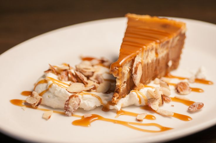 SALTED CARAMEL CHEESECAKE with whipped cream and candied almonds