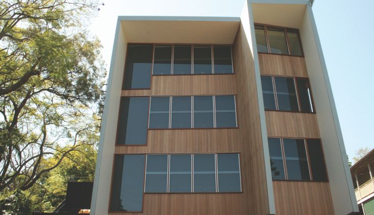 Contemp Clad. Architectural House using Stack Panel Timber Feature Product.