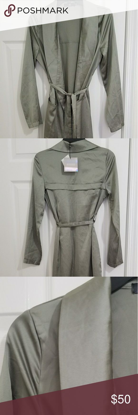 Misguided Sage Green Silk/Satin Duster Trench Coat Brand new with tags. US size 2. Will fit XS or S. Misguided silky light green coat. This color sold out everywhere! Can be worn out for a modern look or at home with cute pajamas. This duster has an amazing soft silky flow Missguided Jackets & Coats Trench Coats