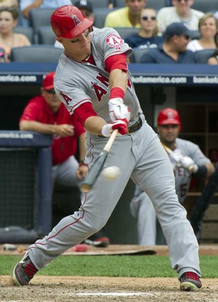 Los Angeles Angels batter Mike Trout hits a run-scoring double against the New York Yankees in the eighth inning of their MLB American League baseball game at Yankee Stadium in New York July 15, 2012.