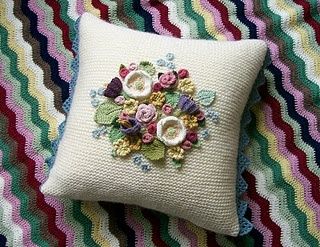Posy Cushion...crochet the pillow and add little crochet flowers on top.