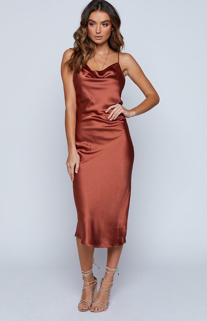 1d967e477c3 The Schiffer Maxi Dress in Rust is the ultimate glam dress for any dressy  occasion this season! Featuring a silky satin fabric all over