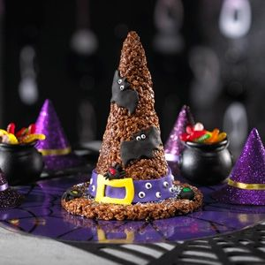 Shape chocolate Rice Krispies Treats into a large witch's hat for a fun and festive centerpiece for your Halloween party's snack table.