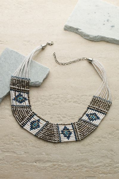 Sardinia Necklace I Tribally glamorous necklace shimmers with metallic seed beads and impresses with meticulous beadwork in turquoise, gold and white geometric patterns. Equal