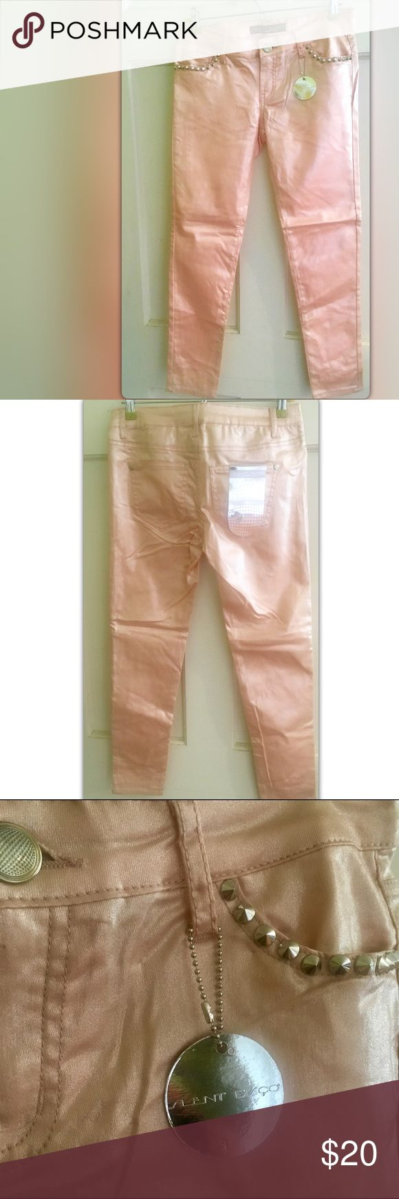"""✨ Shimmery Skinny Jeans ✨ Size 9 1/2 off bundles EVERYDAY! ✨✨ Silent Disco Shimmery Skinny Jeans✨ By Celebrity Pink Pretty, shimmery peach. New!! Size: 9 Waist: 16"""" flat across  Rise: 7 1/2"""" Inseam: 27"""" New! ✨ fabric content in photos .. they do have stretch ✨  ✨Bundle any 2 or more items and save 50% off✨  Respectful offers are always welcome. I will not accept offers for less than 1/2 off.   Thanks for looking! Celebrity Pink Jeans Skinny"""