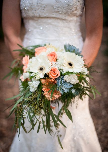 A lovely #bouquet full of roses, gerbera daisies, succulents, and olive branches. {Photo: @bethanyrsnyder; Floral Designer: Robin McCall}