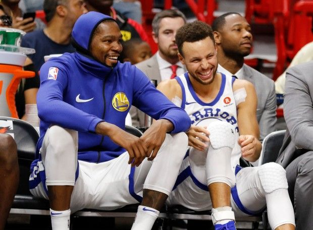Academy of Scoring Basketball - Golden State Warriors Stephen Curry, right, and Kevin Durant react on the bench late in the fourth quarter against the Miami Heat in an NBA basketball game Sunday, Dec. 3, 2017, in Miami. The Warriors won 123-95. (AP Photo/Joe Skipper) TSA Is a Complete Ball Handling, Shooting, And Finishing System!  Here's What's Included...
