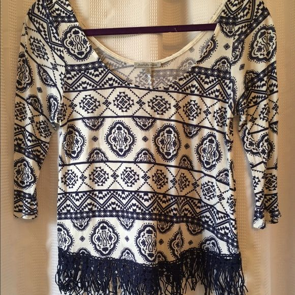 Charlotte Russe blue and white fringed shirt Brand new never worn! Charlotte Russe blue and white shirt with navy blue fringe on bottom. Super comfortable Charlotte Russe Tops