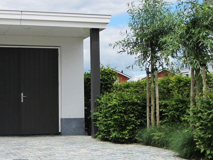 Moderne duurzame tuin oprit voortuin scoria bricks siergrassen knotwilgen 940 705 - Pergola met intrekbaar canvas ...