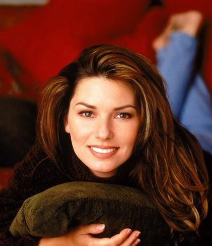 University researchers determine perfect face proportions. Shania Twains' face exactly fits. She is beautiful, but, she has a big nose.