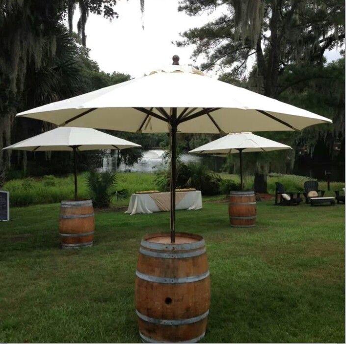 Umbrella wine barrel tables                                                                                                                                                                                 More