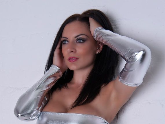 Metallic Silver Shiny Lycra Arm Warmers Fingerless Gloves One Size/Free Size Length: 14.5 Inches Top Of Arm Fits Up To : 12 inches around Wrist Fits up to: 8 inches around Matching Skirt an Tube Top also available