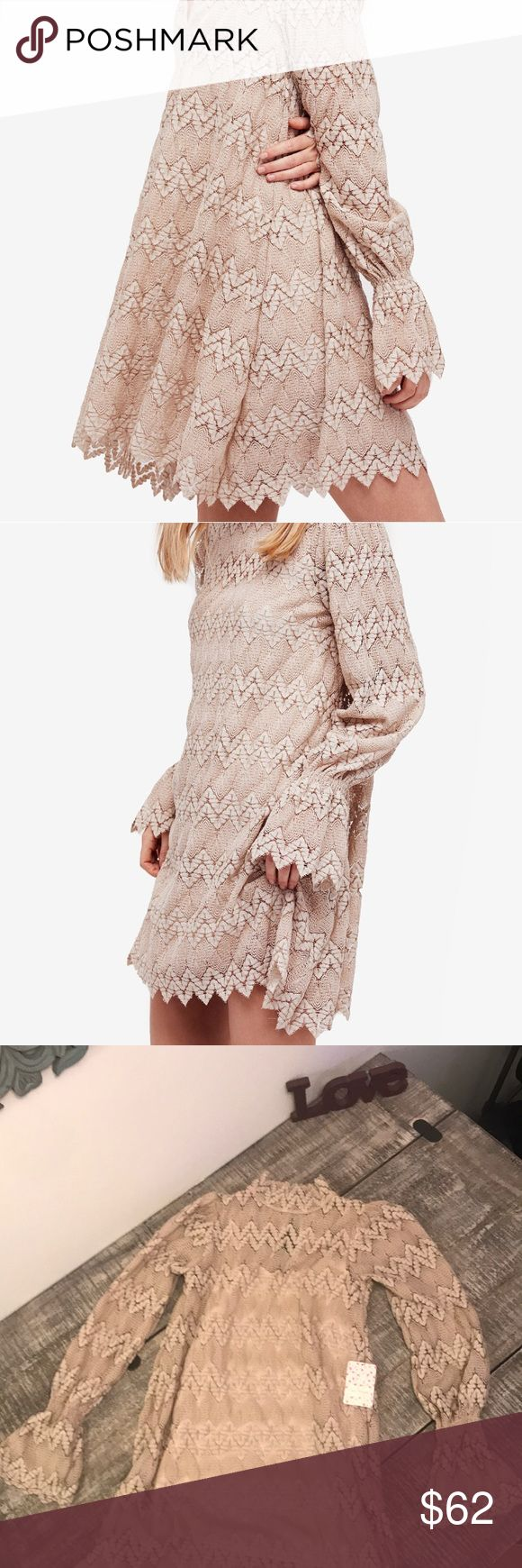 Free people laced dress Bohemian styles dress has a bold lace overlay with bell sleeves. A high neckline and a button closure at the keyhole back. Also comes with an underlay as shown in the last picture Free People Dresses
