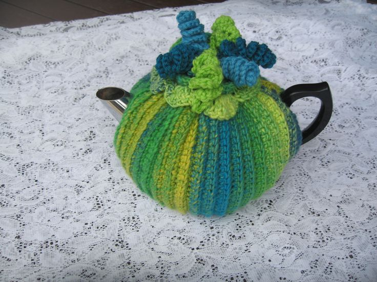 Handmade crochet tea cosy with masses of colourful ringlets.