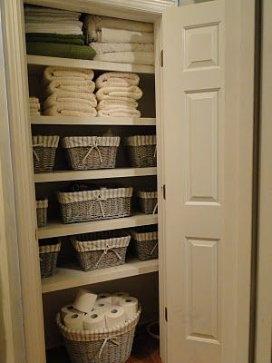 Use baskets as useful and pretty storage solutions for an organized linen  closet
