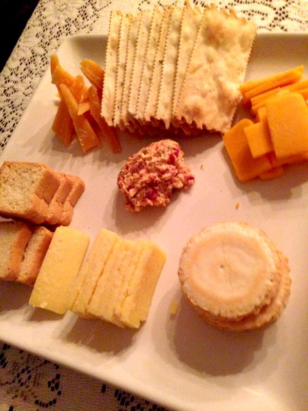 crackers and cheese: anchovie and cheese spread, aged cheddar and other varieties.