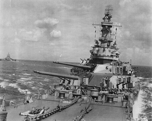 USS Indiana (BB-58) & battleship USS Iowa (BB-61) in the background in 1944.