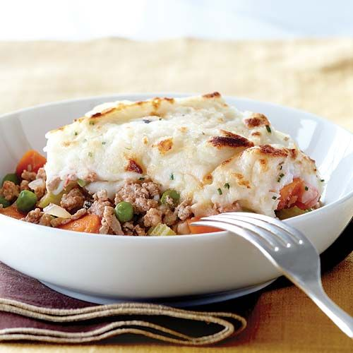 Shepherds Pie with Buttermilk-Chive Mashed Potato Crust      INGREDIENTS:  1 lb Yukon gold potatoes,  1 clove garlic,   2/3 cup buttermilk  1 tbsp chives, chopped  1 lb ground turkey   1 yellow onion,  3 carrots,  1 celery stalk,   1 tsp fresh rosemary   1 cup chicken broth  1 tbsp tomato paste  1/2 cup frozen peas