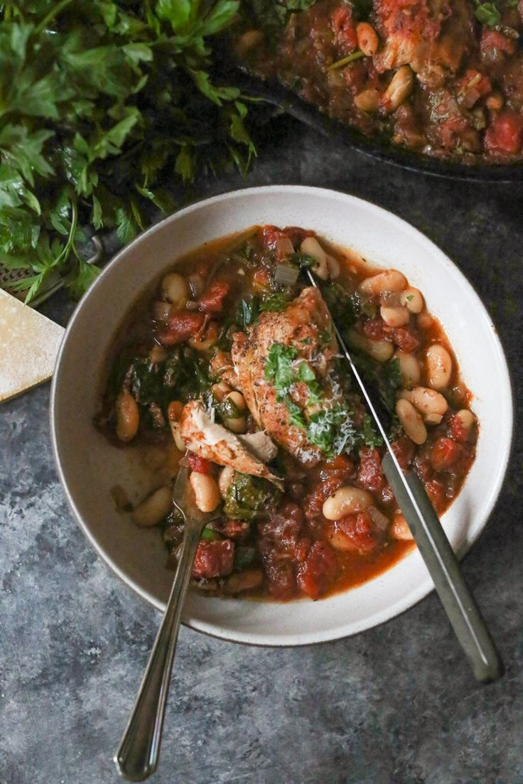 One skillet braised chicken thighs with spinach and white beans