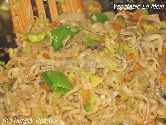 Vegetable Lo Mein - I love lo mein at the local buffet but I'm not real fond of the vegetable to noodle ratio that they have. I do love my vegetables. Since I am not able to find the correct type of noodle for this dish, I compromised with ramen noodles. It was delicious and loaded with veggies.