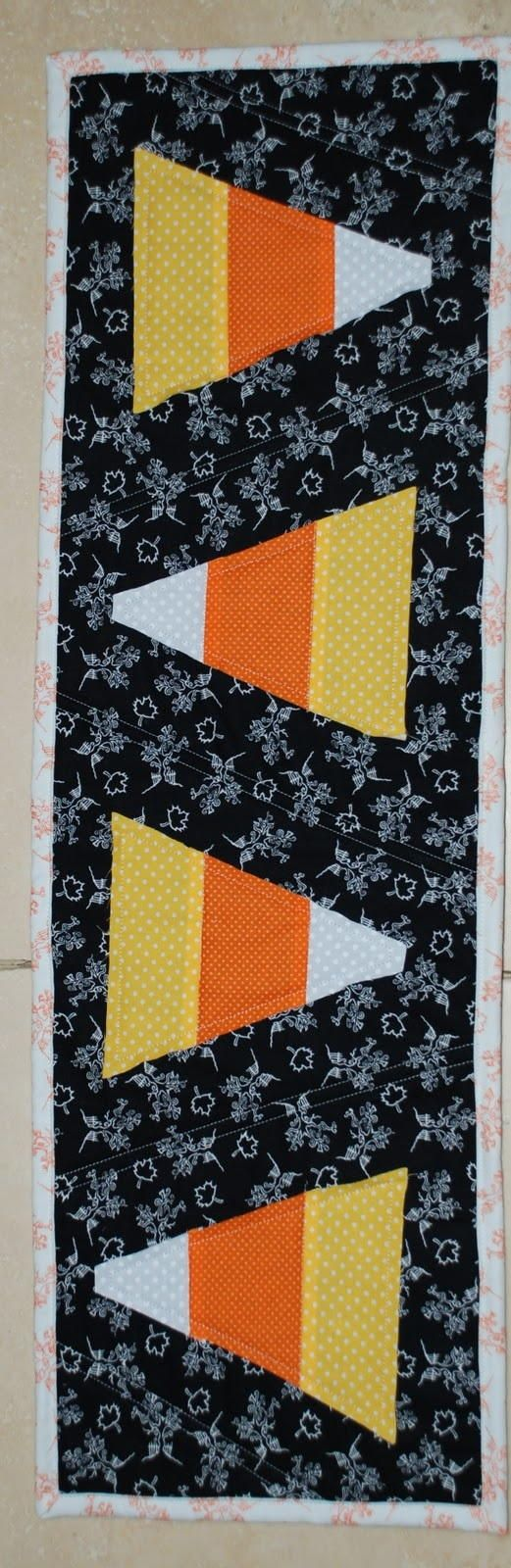 Candy Corn Halloween Runner - Learn how to applique has never been more festive, fun, or easy peasy than with these sweet treat free applique designs. Create this table runner pattern to lay out for trick or treaters, use the applique pattern on other projects, or make this project for a friend.