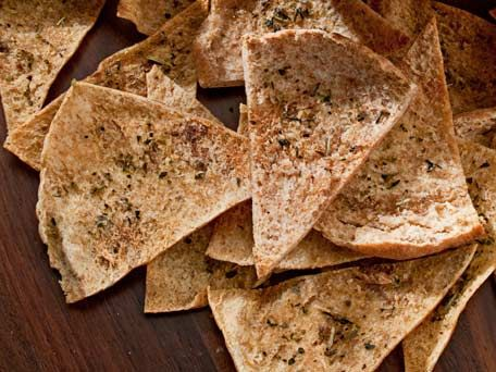 You can make your own tasty pita chips in a matter of minutes. Just cut pita bread into wedges (stale pitas work very well), brush them with a little olive oil and bake. Not only do homemade pita chips save you money, you'll also cut calories by 16 percent.