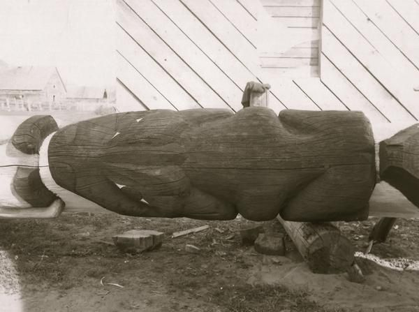 Detail of the large Climbing-Frog.<br><br>This photograph shows this pole lowered as it was recently restored.