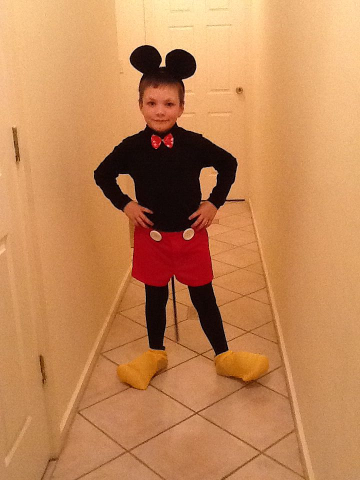 Mickey Mouse for school disco. Was lucky to find the red footy shorts from an op shop for $2. Black leggings sourced from a friend. My son had the black skivvy (which was later reused for the spider costume). Bow and ears bought from a costume shop. I couldn't find big white buttons so had to get wooden ones which I painted white. Shoes were made from the shoulders of a muscle man costume my son had in the costume box... Tail sewed on and we have a Mickey Mouse :)