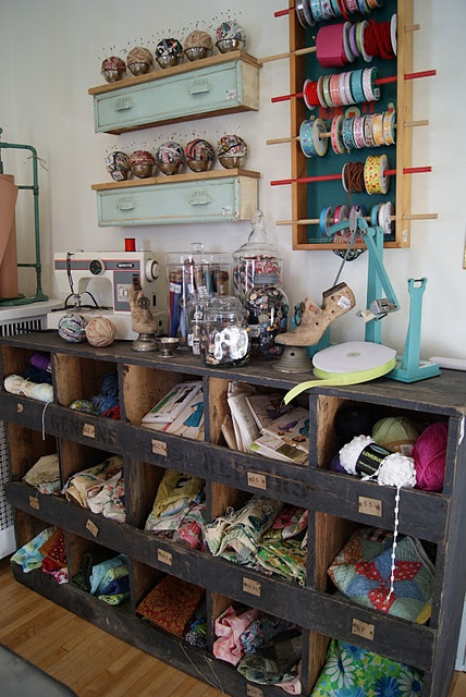 One in the wet lab/art space (painting equipment, canvases, beakers, dishes, jars, collage materials, newspaper, egg cartons etc. craft papers, glues, paints, jars of small items on top) and one in the tech lab/craft space (fabric, yarn, patterns etc. notions, thread, electronics supplies on top). Open for accountability and accessibility but a lip to stop everything falling out.
