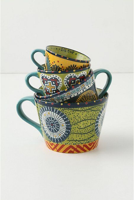 Anthropologie Austin's Flora Measuring Cups. one cup, half cup, third cup and quarter cup.