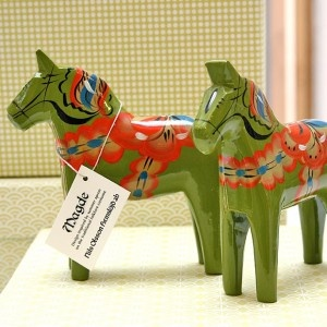 "The authentic wooden Dala horses are produced only in one place in the world and it is in the village of Nusnäs, in the middle of Dalarna, the heart of Sweden.  The traditional patterns are painted free-hand by skilled ""ripples painters"". A difficult art that takes a long time to master.  Finally painted the colourful horses leave Nusnäs and walk out into the world as a symbol of Sweden"