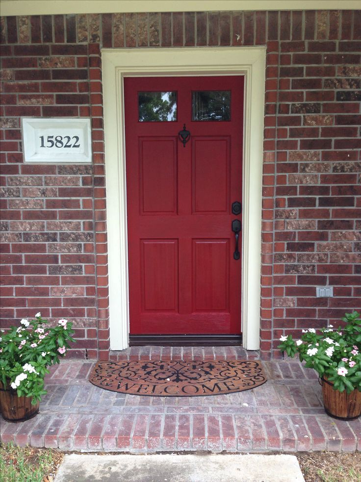 Door color is Front Door Red by Valspar. Front door makeover on red brick house.