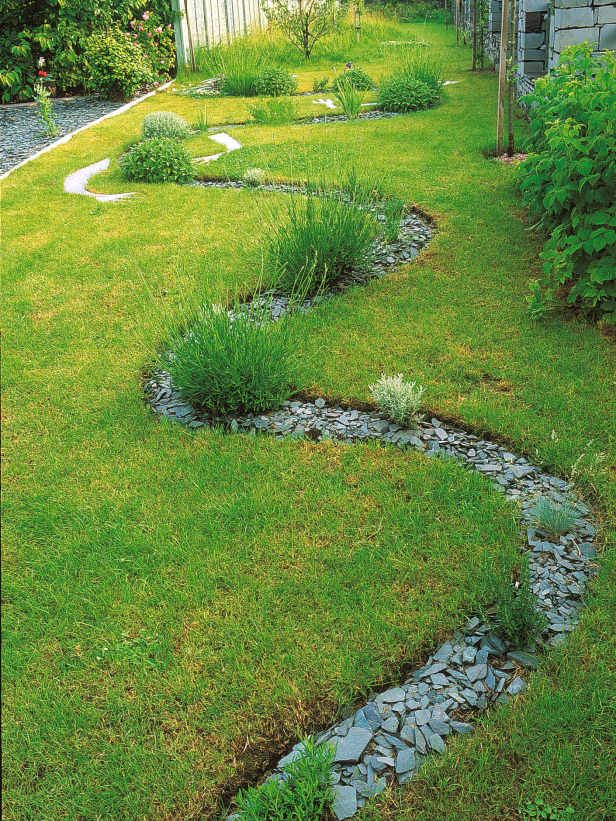 Snaking Path - This flowing S-curved bed can extend the route through a yard, and trick the eye into thinking the space is larger than it is. This stone mulch bed wanders lazily through the lawn. (from HGTV Gardens)