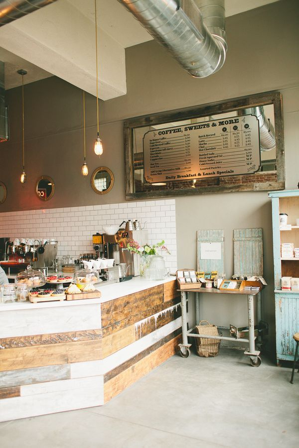 Wood front for counter, simple lights and industrial vents above. Two-tone walls to create depth and line for vision