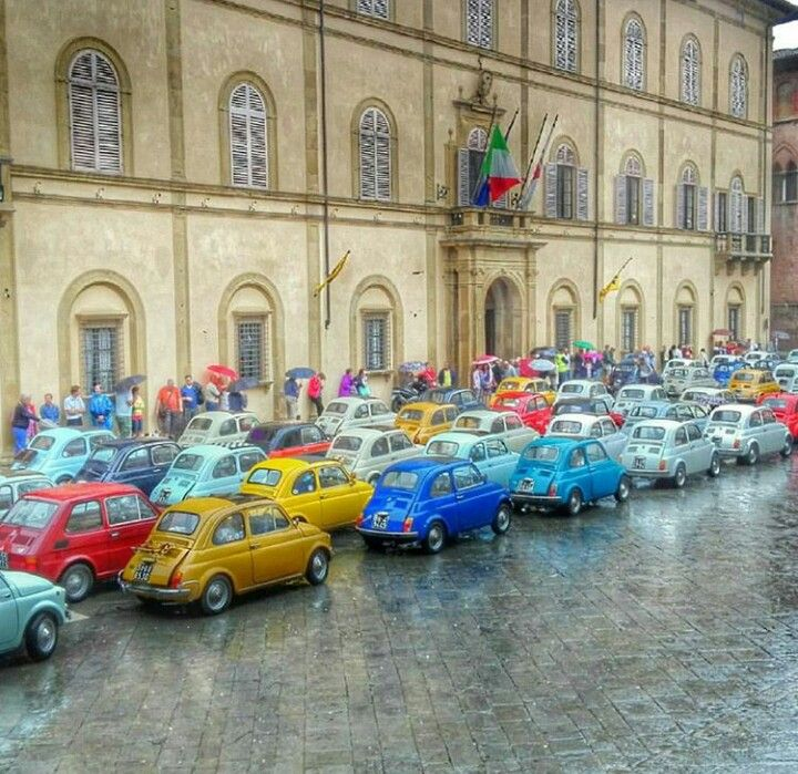A rainbow made of Fiat 500s will brighten a rainy day.