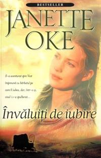 """Învăluiţi de iubire de Janette Oke - Acesta este primul roman dintre cele opt ce alcătuiesc seria """"învăluiţi de iubire"""". Un roman memorabil despre pierdere şi dragoste, conceput în epoca """"casuţei din prerie"""". Acest prim volum ne prezintă povestea lui Marty si Clem, un cuplu de tineri proaspăt căsătoriţi, care pornesc spre Vestul Americii pentru a-şi face un rost în viaţă. Fericirea lor este curmată de moartea lui Cle…"""