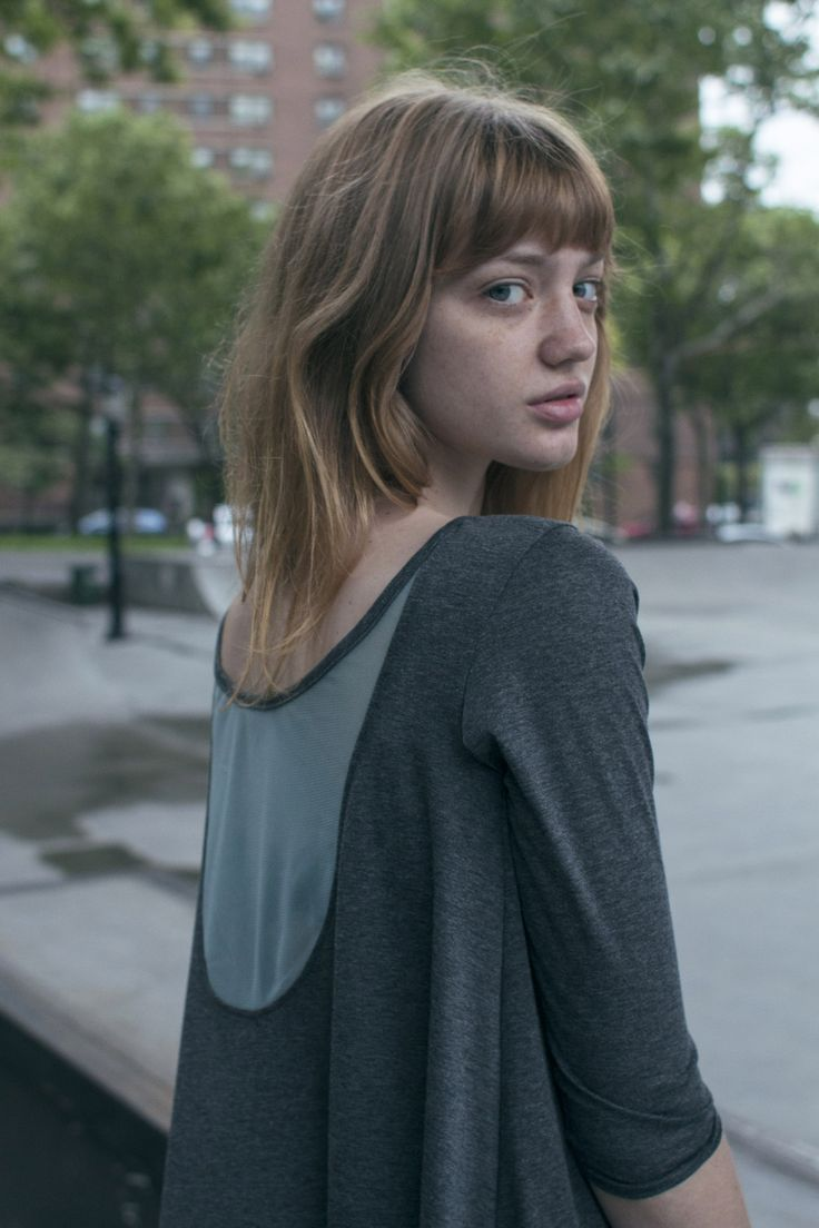 Mesh Detail Tunic features a low back with sheer mesh overlay.   Uye Surana
