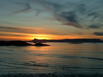 Sunset over the Isle of Eigg taken from the beach by this Touring Caravan & Camping Site on the West Coast of Scotland
