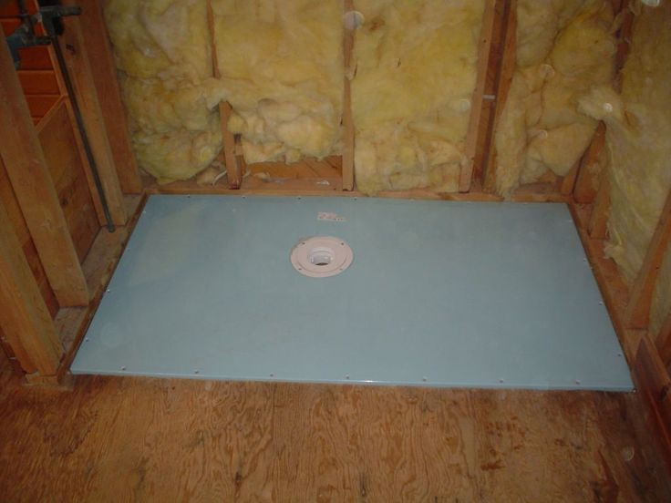 Roll in shower base during installation set on joists 2