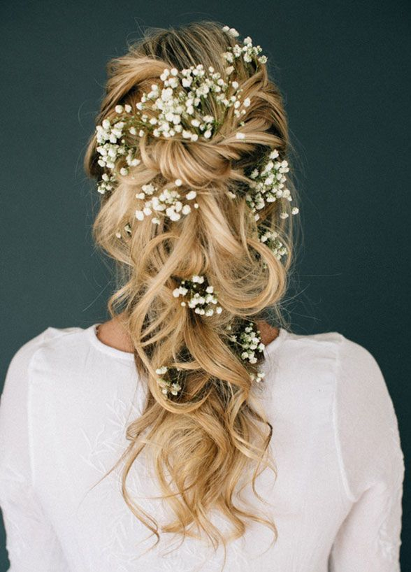 11 Effortlessly Romantic Wedding Hairstyles: Who knew baby's breath could look so magical? Simply twist and pin random, large pieces of curled hair, then add texture with finishing spray.