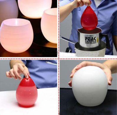 make candle luminaries by dipping water balloons in wax