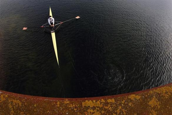 A British rower prepares before the GB Rowing Team Senior Trials at the Olympic rowing venue in Eton-Dorney near London March 11, 2012.  REUTERS/Stefan Wermuth