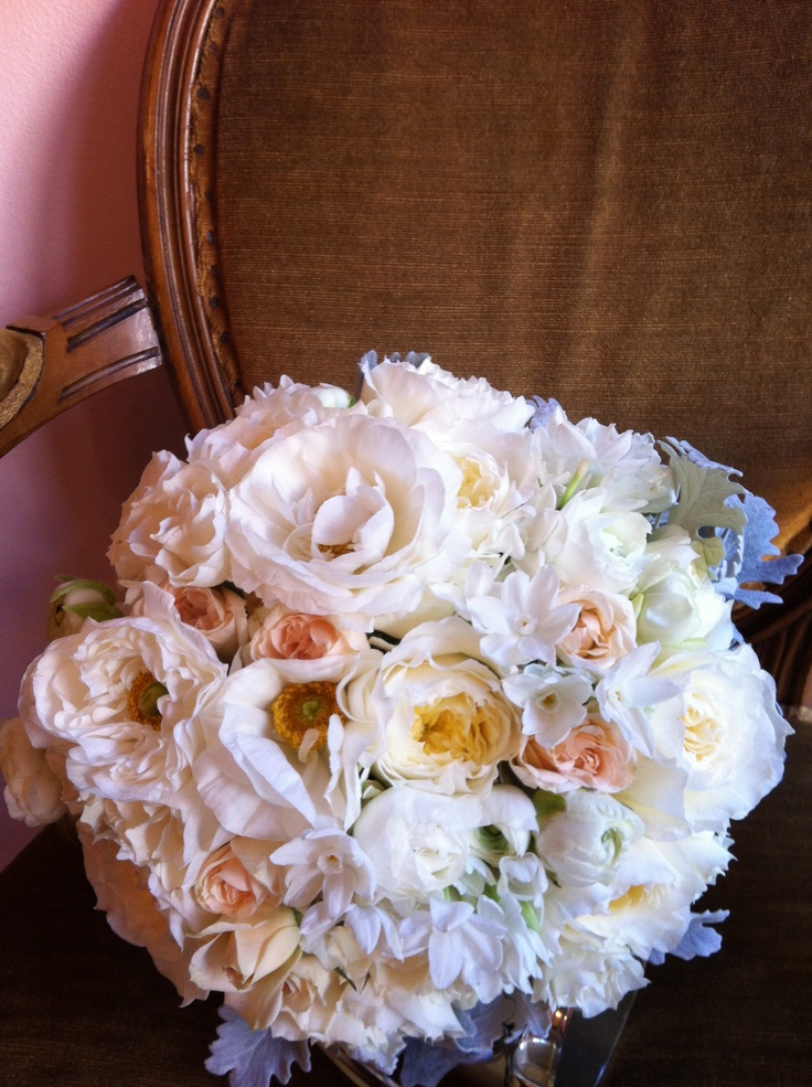 bridal bouquet of garden roses, ranunculus and paperwhite narcissus