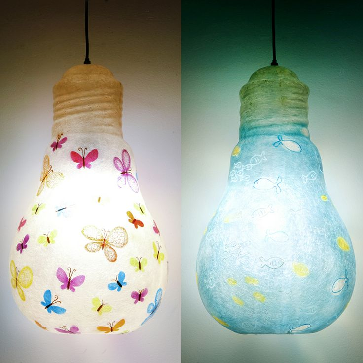 Lightbulb - hanging lamp 2 designs  Hanging lamp made of fiberglass, in the shape of a light bulb  Fiberglass material is robust and lightweight  Dimensions: 52 x 30 cm  It has a hole at the bottom for changing the light bulb.
